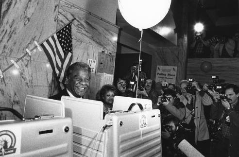 Former Chicago Mayor Harold Washington at a voting booth.