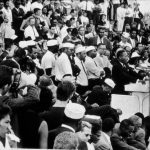 Martin Luther King, Jr. speaks from behind a podium to a crowd during the March on Washington for Jobs and Freedom in Washington, District of Columbia, August 28, 1963.