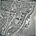 Black and white aerial photo of town along Mississippi River
