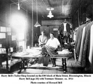Harry Bell and Torrence Skinner stand behind a table piled with clothes