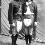 (Left to right) Ernest Clarke and his daughter Ernestine. They wear traditional Scottish costumes, with berets and plaid kilts