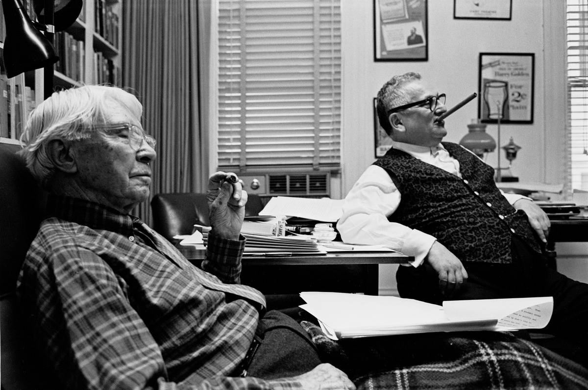 Writers Carl Sandburg (left) and Harry Golden sit in Golden's office following the publication of his biography of the poet titled Carl Sandburg