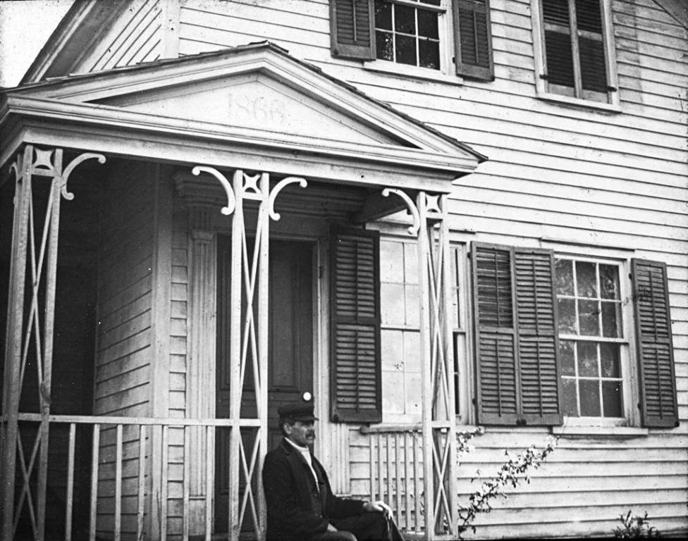 Man_Sitting_on_the_Front_Stoop_of_a_House