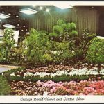Postcard showing a display of trees and flower beds at the Chicago World Flower and Garden Show.