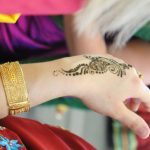 Photograph of an Indian Mehndi sometimes called henna tattoo on someone's hand