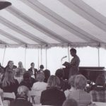 Gwendolyn Brooks reads to the audience at the Ferry Hall Centennial Celebration. At that time she was Poet Laureate for the State of Illinois. In 1985 she became the Library of Congress's Consultant in Poetry, whose title changed the next year to Poet Laureate.