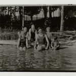 Black and white photo of the Hemingway siblings gathered on the shore of a lake.
